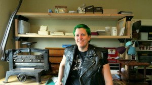 Ealasaid in front of her bookbinding workbench