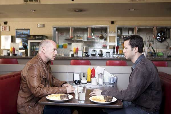 """Bruce Willis and Joseph Gordon-Levitt in Looper"""