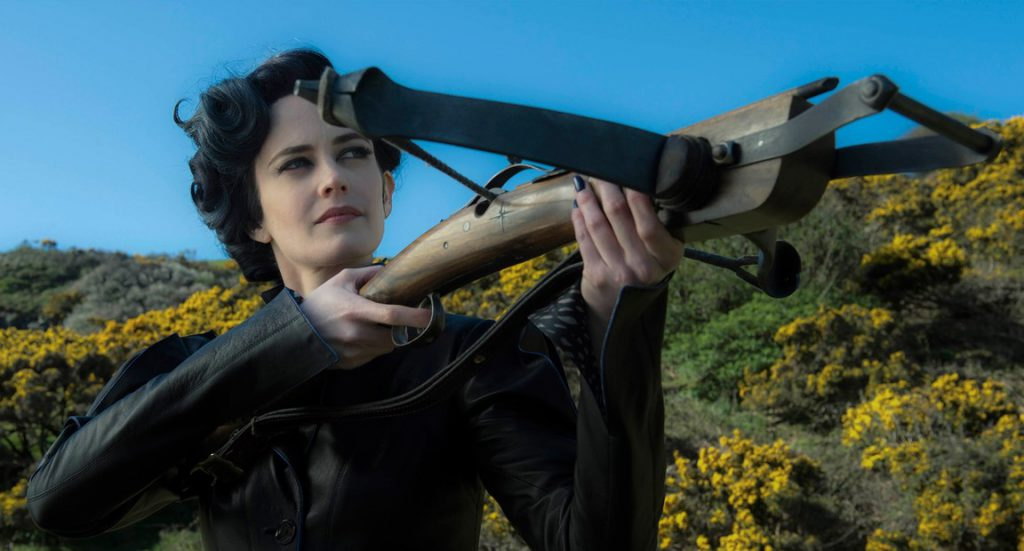Eva Green, a thin person with pale skin and dark hair, is pointing a crossbow at something out of the frame. She is wearing stylized 40's formalwear.
