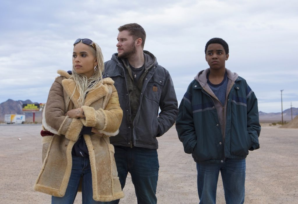 A medium shot of three people. L-R: Zoe Kravitz, Jack Reynor, and Myles Truitt.